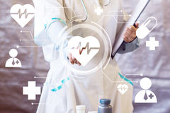 Doctor pushing button heart pulse virtual healthcare network.  Stock Image