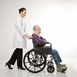 Doctor pushing patient Royalty Free Stock Photo