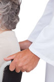 Doctor pushing patient in wheelchair Royalty Free Stock Photo