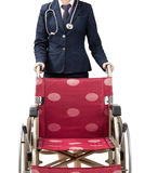 Doctor pushing wheelchair. Doctor pushing an empty red wheelchair Stock Image