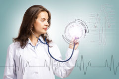 Doctor put a stethoscope to the glowing dashboard Stock Photo