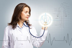 Doctor put a stethoscope to the glowing dashboard Stock Photos