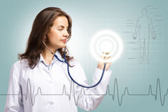 Doctor put a stethoscope to the glowing dashboard Royalty Free Stock Photos