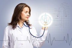 Doctor put a stethoscope to the glowing dashboard Royalty Free Stock Photo