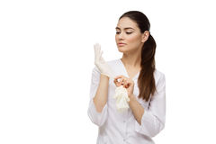 Doctor putting on gloves Royalty Free Stock Photo