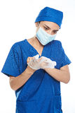 Doctor putting gloves on Royalty Free Stock Image