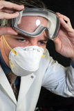 Doctor Putting On Goggles Stock Image