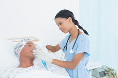 Doctor putting an oxygen mask. In the hospital royalty free stock photo