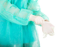 Doctor putting sterilized medical glove. Doctor putting sterilized medical glove for operation Royalty Free Stock Photos