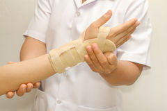 Doctor putting wrist brace Royalty Free Stock Photos