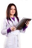Doctor que cuida joven en el uniforme blanco Fotos de archivo libres de regalías