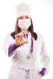 Doctor que cuida joven en el uniforme blanco Fotografía de archivo