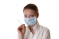 Doctor que sostiene un cigarrillo Fotografía de archivo libre de regalías