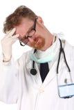 Doctor que tiene dolor de cabeza foto de archivo libre de regalías
