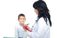 Doctor questioning boy Stock Photography