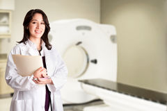 Free Doctor Radiologist At CT CAT Scan With Chart Stock Photos - 21019783