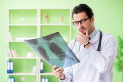 The doctor radiologist looking at x-ray scan in hospital stock photo