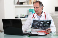 Doctor with x-ray in hand Stock Photos