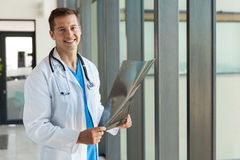Doctor x-ray picture. Good looking male doctor with x-ray picture in hospital Royalty Free Stock Photography