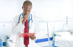Doctor reading a case history Royalty Free Stock Photography