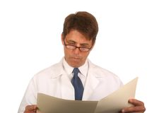 Doctor Reading Chart Royalty Free Stock Photos