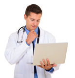 Doctor reading email. Modern young doctor reading email on his laptop Stock Photo