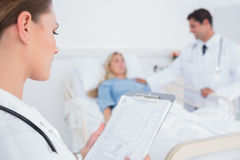 Doctor reading folder of a patient Stock Photo