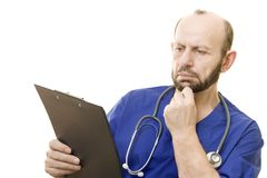 Doctor reading notes Royalty Free Stock Photography