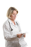 Doctor reading package insert Royalty Free Stock Photo