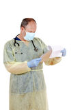 Doctor reading a patient chart Royalty Free Stock Images