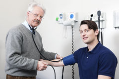 Doctor Reading Pulse Rate Of a Patient Stock Photo
