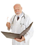 Doctor - Reads Chart Royalty Free Stock Image