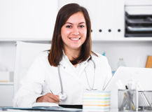 Doctor ready for clients. Young female doctor ready to receive clients in her office stock image