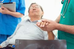 Doctor reassuring his male patient and consulting health problem royalty free stock images