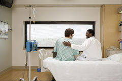 Doctor reassuring patient Royalty Free Stock Images