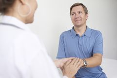 Doctor reassuring patient royalty free stock image