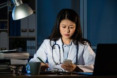 Doctor received bad news from smartphone message Royalty Free Stock Photography