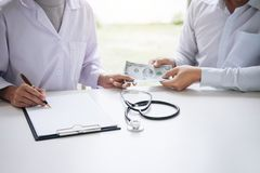 Doctor received corruption money from businessman form of dollar Stock Photo