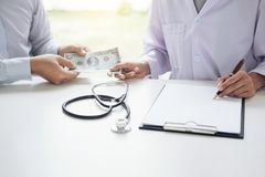 Doctor received corruption money from businessman form of dollar Stock Image