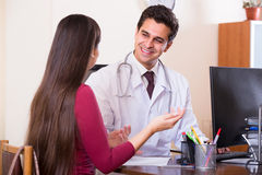 Doctor receiving ill patient Stock Images