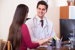 Doctor receiving ill patient Royalty Free Stock Photos