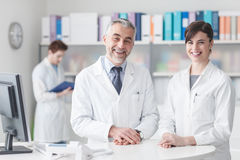 Doctor at the reception desk with his assistant Royalty Free Stock Images