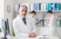 Doctor at the reception desk Stock Images