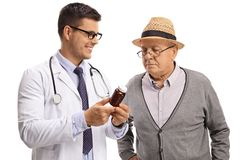 Doctor recommending pills to a mature man Stock Photo