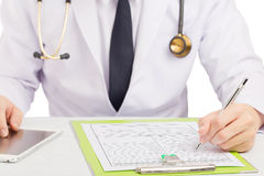 Doctor record history or filling medical form. Royalty Free Stock Photos