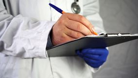 Doctor records the results of patient treatment