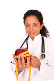 Doctor with red apple Royalty Free Stock Photography