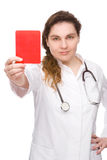 Doctor with red card. Full isolated studio picture from a doctor with red card Royalty Free Stock Photography