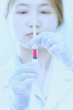Doctor with red vaccine syringe in hand Royalty Free Stock Photo
