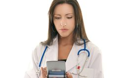 Doctor referencing information on a portable device Royalty Free Stock Photography